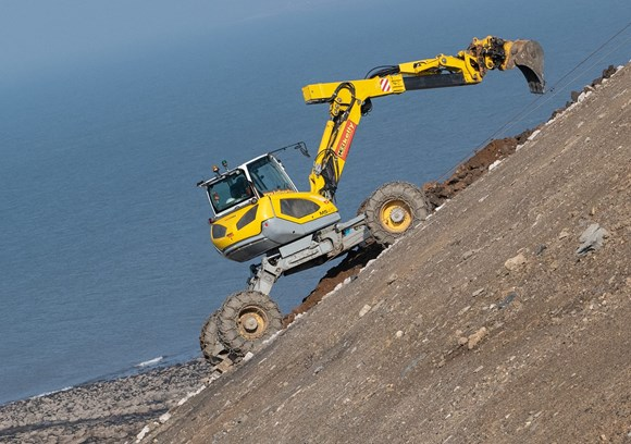 Specialist digger used on steep slope - Photo credit: J Murphy & Sons